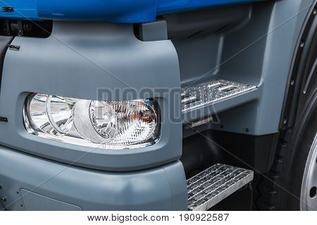 cab and bumper with the headlights of trucks. Focus on the headlight