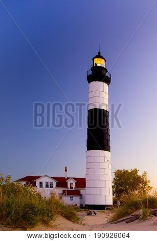 Illuminated beacon of the Big Sable Lighthouse on the shores of Lake Michigan in Ludington State Park