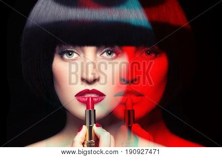 Woman with double personality applying lipstick isolated