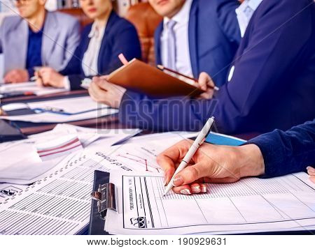 Business people office life of team people working with papers sitting table. Schemas and diagrams close up. Work of accountant.