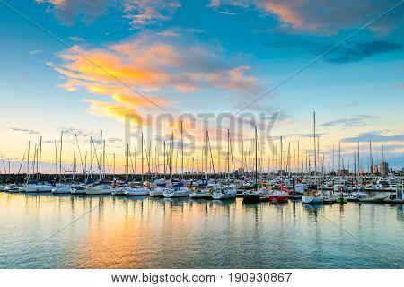 Yachts anchored in a row at St. Kilda beach Victoria Australia