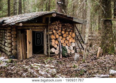 Old wooden hunting lodge in the forest.