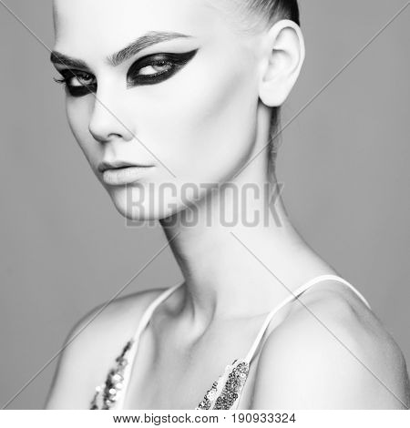 Studio photo of elegant lady with color smoky eyes makeup. Young woman with fashionable makeup