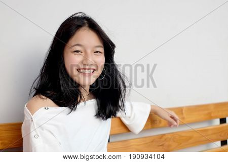 Asian Girl Smile With Retainer Tool
