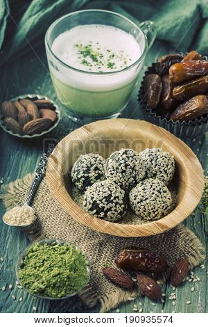 Matcha energy balls from dates and almonds and matcha green tea latte