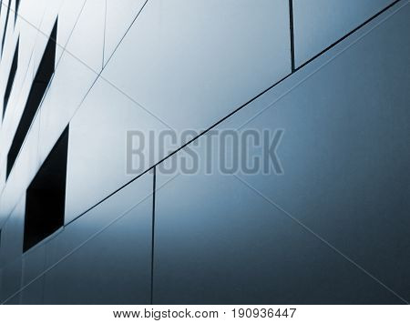 abstract image of metallic cladding on modern industrial building in blue