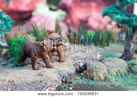 select focus bear toy looking sunlight in artificial jungle