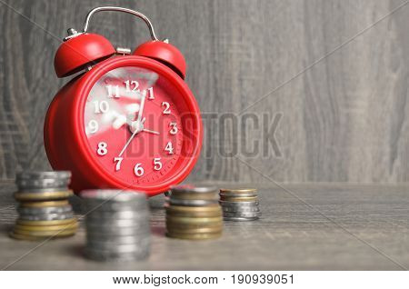 Old Style Red Clock With Some Money Around