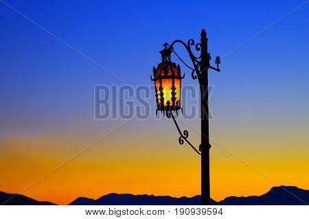 Sundown with street lantern in Ronda village Spain.