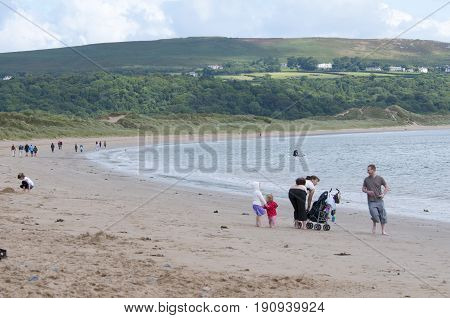Oxwich beach, Wales, 14-08-2010: A bunch of people all relaxing on the beach in Wales.