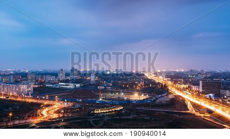 Minsk, Belarus - April 6, 2016: Aerial View Cityscape In Bright Blue Hour Evening And Yellow Illumination Spring Twilight.  Night View Of Independence Avenue