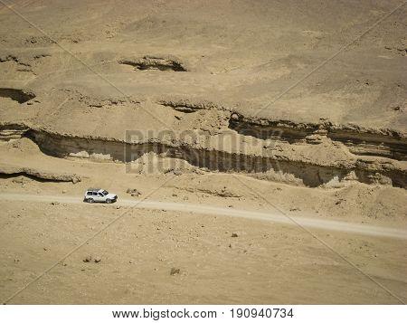 Four Wheel Drive Car in the Desert Wadi