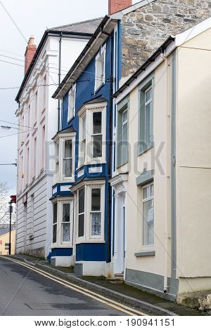 Upright shot of a residential street with houses in Cardigan Ceredigion Wales United Kingdom