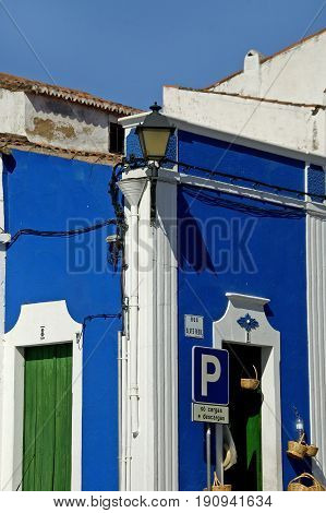 Alentejo, Portugal, 25-September-2007: Someone has just walked into a clear blue traditional house in Mertola village.