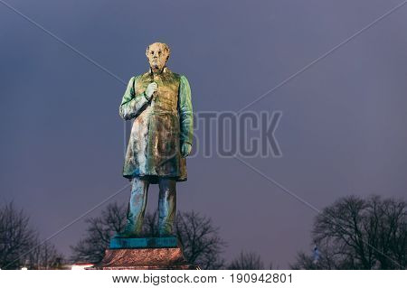 Helsinki, Finland. Close Up Of Statue Of Johan Ludvig Runeberg On Esplanadi Park In Lighting At Evening Or Night Illumination. Famous Landmark. Monument To National Poet And Lyric Of Finland.