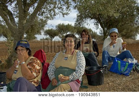 Alentejo, Portugal, 26-September-2007: Four women taking a break from their hard work at the wine plantation to eat some lunch in Alentejo.