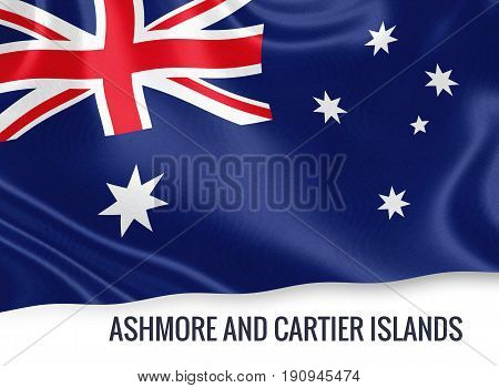 Australian state Ashmore and Cartier Islands flag waving on an isolated white background. State name is included below the flag. 3D rendering.