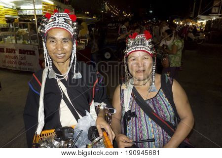 Chiang Mai, Thailand, 25-May-2011: Two women wearing traditional head garments in Chiang Mai.