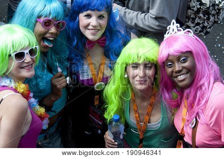 Brussels, Belgium, 14-May-2011: A group of people wearing colourful wigs at the gay pride in Brussels.