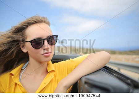Teenager with sunglasses on vacation
