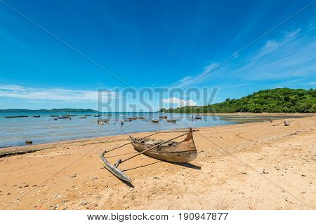 Traditional pirogue on the shore of Nosy Be island in Madagascar Africa.