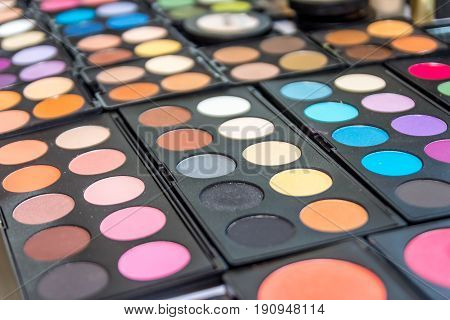 Colorful eyeshadow palette, decorative cosmetics for makeup. Close-up, selective focus