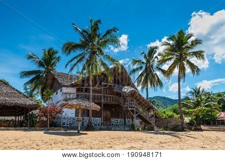 Ampasipohy Nosy Be Madagascar - December 19 2015: Colonial house on the beach in the fishing village Ampasipohy on the island of Nosy Be Madagascar.