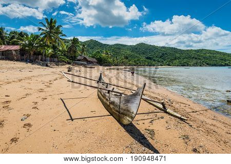 Ampasipohy Nosy Be Madagascar - December 19 2015: Traditional pirogue in the fishing village Ampasipohy on the island of Nosy Be Madagascar.