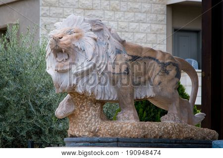 CANA OF GALILEE, ISRAEL - DECEMBER 3: Statue of the stone lion before the entrance of the house in Cana of Galilee, Israel on December 3, 2016