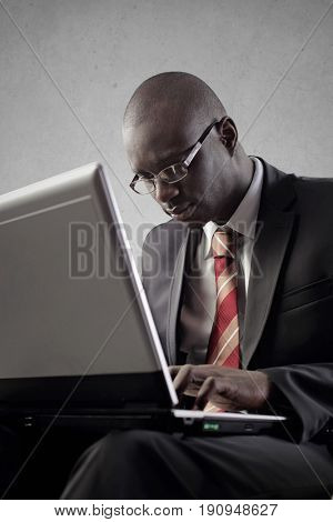Elegantly dressed manager using a pc