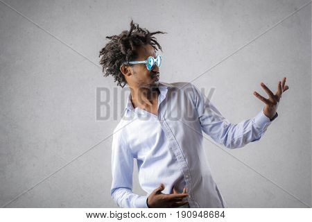 Stylish man pretending to play the guitar