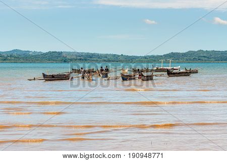 Ampasipohy Nosy Be Madagascar - December 19 2015: Aboriginal traditional Malagasy pirogue - wooden outrigger canoes (carved from a tree trunk) at Nosy Be Island Madagascar.