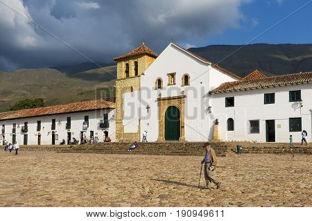 Villa de Leyva Colombia - February 14 2014: People in the main square of the historic Villa de Leyva in Colombia. Villa de Leyva is one of the finest historic villages in Colombia.