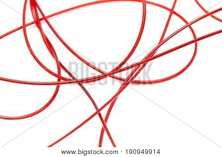 red wire on a white background. A photo