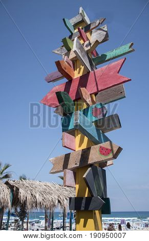colorful sign points the way to the different destinations