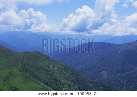 Beautiful mountains view. Natural background. High in the mountains. Landscape with alpine meadows.