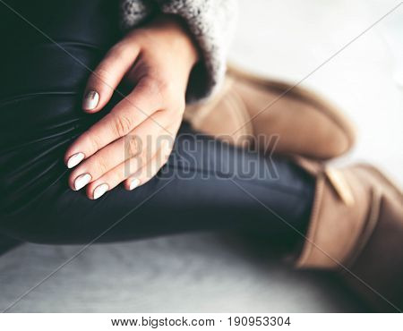 The girl with a nice manicure gray dress ugg boots. Shoes, fashion, style, modern