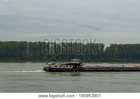 Pass  tug-boat  in the river Danube along Vidin port, Bulgaria, Europe