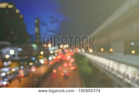 Blurred urban traffic background scene at night. Bokeh with colorful lights in evening time for background.