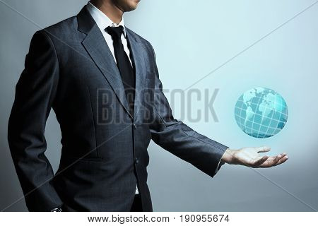 Businessman is holding the world hologram business global online concept viral marketing business background.