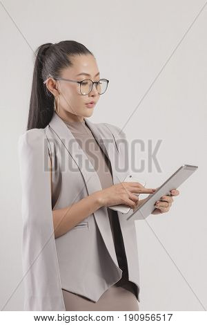 Asian girl working in the office ,woman working with new startup projectyoung business ,woman working with laptop.