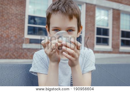 kid playing with a spinner. closeup. boy looking at a spinning fidget spinner.