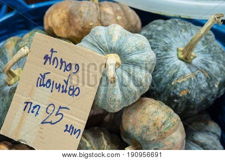 Pile Of Pumpkin In Marke Thailand, The Price Tag In Thai Language Means
