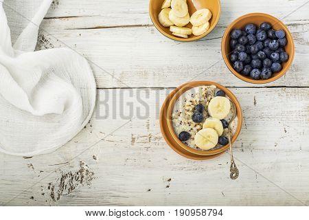 Sweet milk porridge quinoa with honey and walnuts. Top view.