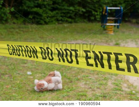 Police barricade in front of a crime scene on a playground