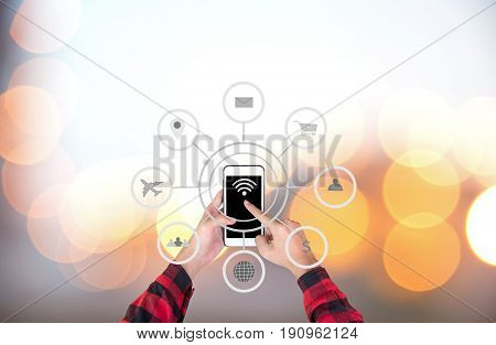 Businessman touching smart phone automation concept with icons showing the functionalities of this new technology