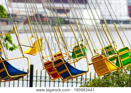 Multicolored carousel in the park, entertainment for children
