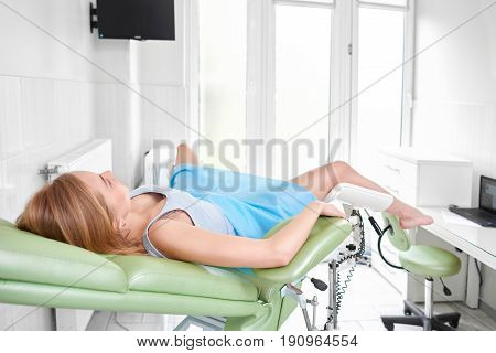 Rearview shot of a woman lying on gynecological chair waiting for medical examination. Copyspace. Gynecology feminine health concept.