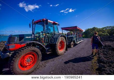 AUCKLAND, NEW ZEALAND- MAY 12, 2017: Unidentified people on a trip on a truck in a rocky road inside of the volcanic Rangitoto island, in a sunny day.