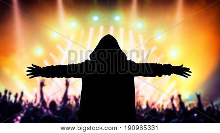 Silhouette of a dj on the party, people enjoying a good music on the concert, have fun on a dance floor, holidays and active nightlife concept